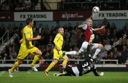 Cardiff City's Joe Lewis saves West Ham United's Mladen Petric attempt on goal