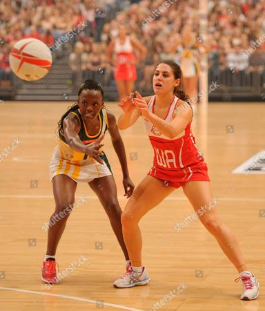 Mia Ritchie of England passes the ball under pressure from Nokuthula Qegu of South Africa
