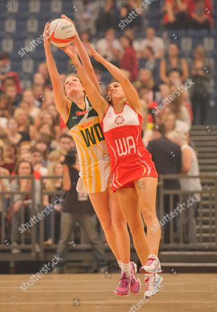 Mia Ritchie of England reaches for the ball with Karla Mostert of South Africa