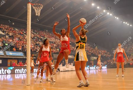 Stacey Francis of England Netball blocks the shot of Maryka Holtzhausen of South Africa