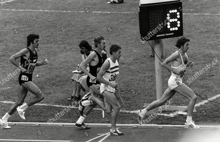 Athletics - 1976 Montreal Olympics - Men's 5000m Final Great Britain's Brendan Foster leads his teammate Ian Stewart (380) and the New Zealanders Dick Quax (691) and Rod Dixon (689) in the Olympic Stadium Quebec Canada Foster went on to finish in fifth place Stewart seventh Dixon fourth while Quax took the silver 1976 Montreal Olympics