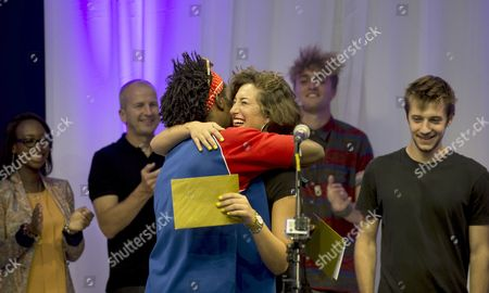 Stock Picture of Group 'Stella Star' (Stella Charalambous) from Enfield who was crowned Gigs Champion congratulated by singer-songwriter Josh Osho (far left)