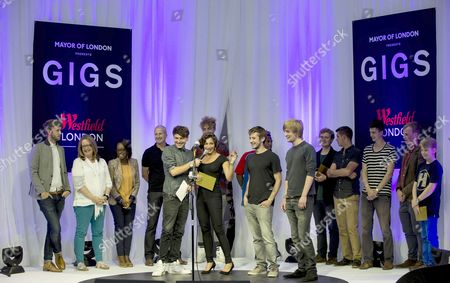 Group 'Stella Star' from Enfield are crowned Gigs Champion. (Centre L to R: Stella Star (Stella Charalambous), 23, Jack Gillen, 21 and Will Jackson, 20 are congratulated byXfm DJ Phil Clifton (centre left).