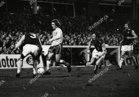 Norman Whitehead (Chester) takes on Charlie Aitken (3) and Bobby McDonald (right) League Cup Semi final at Villa Park Aston Villa v Chester city 22/01/1975 Lge Cup SF2: A Villa 3 (5) Chester 2 (4)