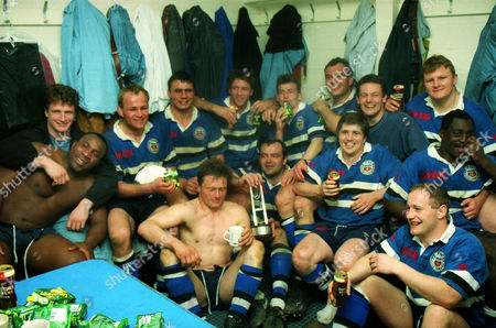 Rugby Union - 1993 / 1994 Courage Club Championship - Bath vs Harlequins The Bath team celebrate winning the Courage League Division 1 title in the Rec changing room Mike Catt is far left and Stuart Barnes middle right with a can of beer Bath vs. Harlequins
