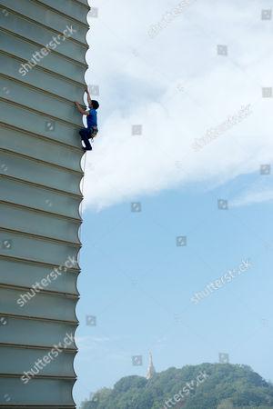 Stock Photo of David Lama climbs the Kursaal building