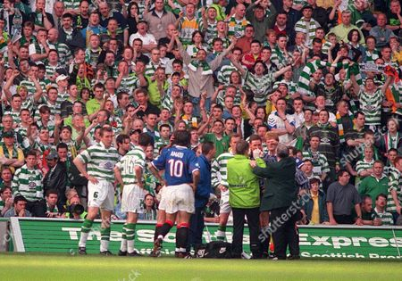 Hugh Dallas (Referee) recieves treatment for his head wound after a Celtic fan hit him on the head with a coin Celtic v Glasgow Rangers 02/05/1999 Great Britain Glasgow
