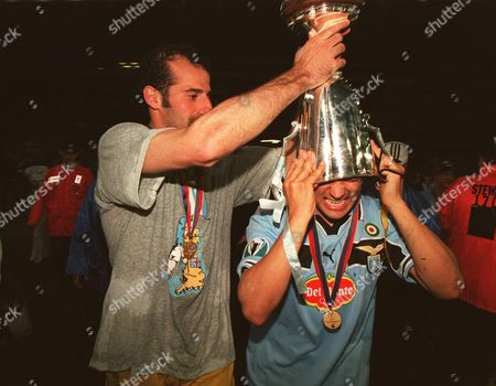 Lazio's Giuseppe Pancaro celebrates by putting the Cup Winners Cup on team mate Sergio Conceicao Real Mallorca v Lazio 19/05/1999 Birmingham Cup Winners Cup Final 1998/9 Great Britain Birmingham