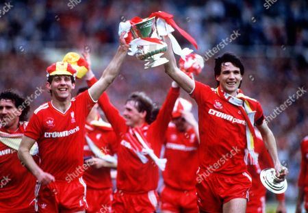 Alan Hansen (left) and Jim Beglin parade the FA Cup after Liverpool's victory Liverpool v Everton FA Cup Final 1986 at Wembley Stadium Great Britain London