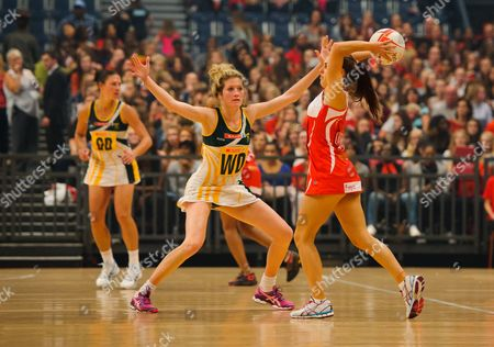 Mia Ritchie of England Netball passes the ball