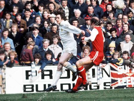 Stock Image of Duncan McKenzie (Leeds) and Terry Mancini (Arsenal) Leeds United v Arsenal 27/3/76 Great Britain Leeds