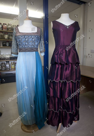 Stock Photo of Downton Abbey dresses: Lady Sybil (left) and Lady Mary designed Susannah Buxton