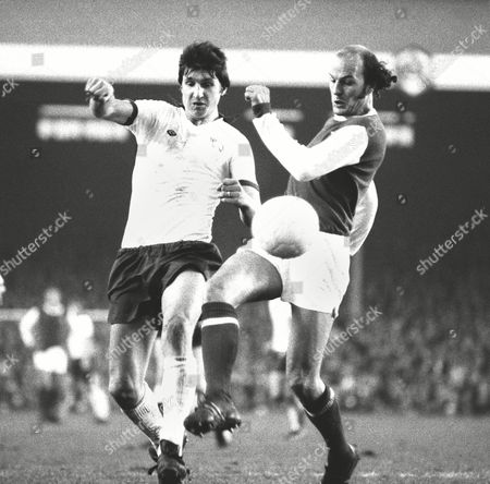 Terry Mancini - Arsenal Wins a ball from Roger Davies - Derby County Arsenal v Derby County 16/11/74 Great Britain Derby