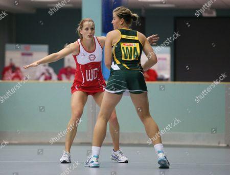 Sara Bayman of England Netball looks to defend