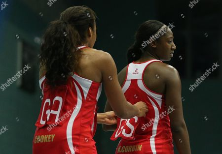 Pamela Cookey of England Netball replaces the position sign on the kit of team mate Kadeen Corbin