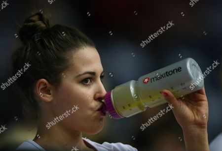 Mia Ritchie of England netball drinks from a Maxitone bottle