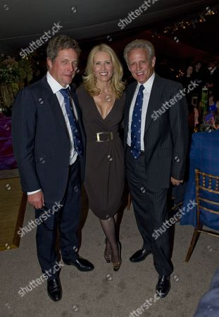 Stock Image of Hugh Grant with Kathrin Nicholson and Don Felder