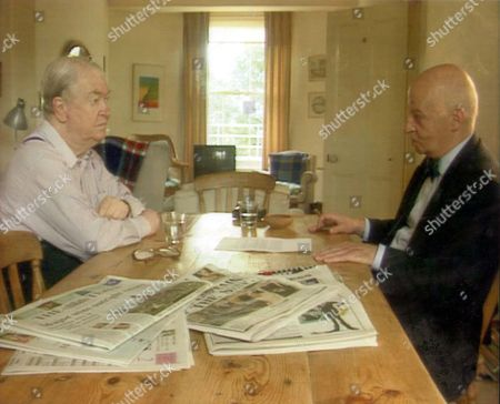 Sir Kingsley Amis Author At Kitchen Table With Unnamed Man 1995.