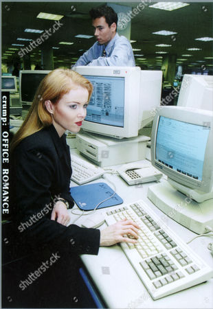 Woman Office Worker At Computer While Male Colleague Looks On For Feature On Office Romance- Posed By Models 1995. **image Was Used 03/04/2000 P.52 To Illustrate An American Sitcom Entitled 'oh Baby'. The Female Model In The Picture Was Incorrectly Identified As Cynthia Stevenson The Star Of 'oh Baby'**.