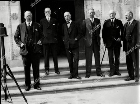 The Prime Minister And His Team Making A Film On The Steps On The Steps Of The New Parliament Building Lord Craigavon (prime Minister) The Rt Hon H.w.pollock (finance) Dr Dawson Bates (home Office) Rt Hon J.m.andrew (men Of Labour) Sir E Archdale (agriculture) Rt Hon J.milne Barbour (commerce).