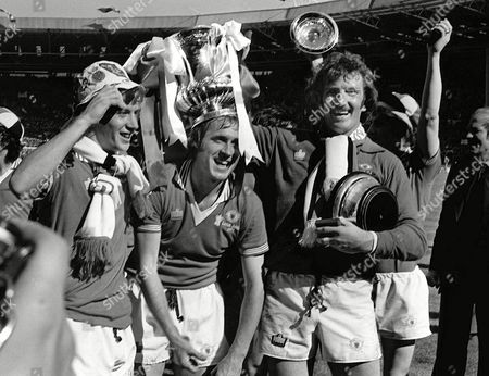 Alex Stepney (Right) Jimmy Greenhoff (Centre) Jimmy Nicol (Right) (Manchester United) celebrate with the FA Cup trophy FA Cup Final 1977 Manchester United v Liverpool at Wembley Great Britain London FA Cup Final