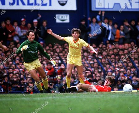 Jim Beglin (Liverpool) Bruce Grobbelaar (left) Norman Whiteside (ground) Liverpool v Manchester United FA Cup Semi Final 13/4/85 at Goodison Park Great Britain Liverpool