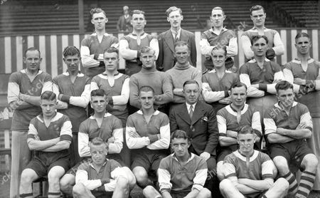 Walsall 1937-38 (back row L>R) Bennett Robinson A Wilson (Secy) Woolhouse Bradford (standing L>R) Morgan Harper Dodds Williams H Wait (Trainer) Simpson Dunderdale Askew (sitting L>R) Redwood Evans Shelton Mr T Lowes (Manager) Smith Wiles (on ground L>R) Richmond Bulger Ashley Great Britain Walsall FC 1937-38