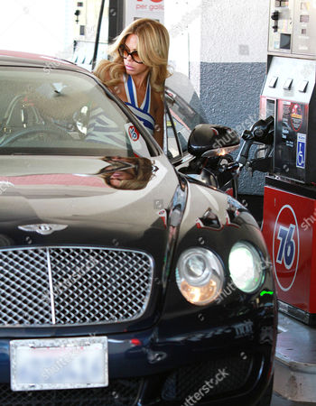 Shauna Sand stops to refuel her car