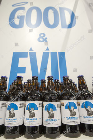 Good and Evil stand with mock beers devoted to Margaret Thatcher