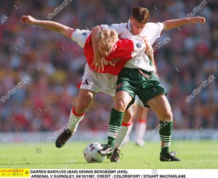 DARREN BARNARD (BAR) DENNIS BERGKAMP (ARS) ARSENAL V BARNSLEY 04/10/1997 Great Britain London