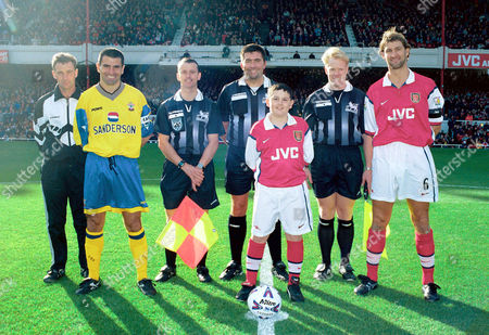 Tony Adams (Arsenal) with the mascot and the match officials and Francis Benali (Southampton) Arsenal v Southampton FA Carling Premiership 17/10/98 Great Britain London