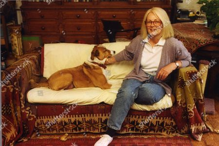 Daphne Bewes (nee Black) Wife Of Actor Rodney Bewes Photographed At Her Putney Home With Her Dog Harvey. She Sits On A Sofa With The Dog.
