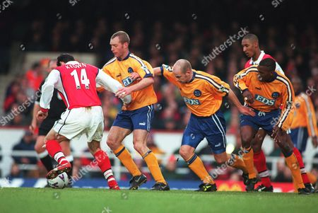Martin Keown (Arsenal) is trailed by Spencer Prior Lee Carsley and Darryl Powell (Derby) Arsenal v Derby County 06/03/1999 F A Cup 6th round Great Britain London