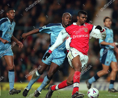 Stock Image of Kanu (Arsenal) gets away from Paul Williams and Carlton Palmer (Coventry City) Coventry City v Arsenal FA Premiership 26/12/1999 Great Britain London