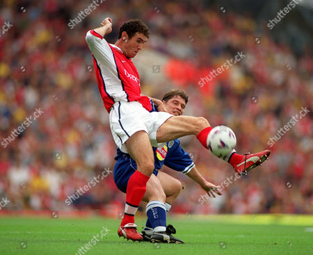 Martin Keown (Arsenal) Tony Cottee (Leicester) Arsenal v Leicester City 7/8/99 Great Britain London
