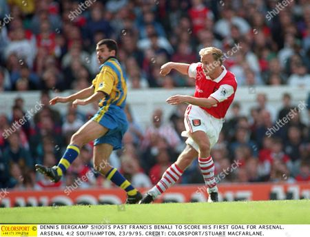 DENNIS BERGKAMP SHOOTS PAST FRANCIS BENALI TO SCORE HIS FIRST GOAL FOR ARSENAL ARSENAL 4:2 SOUTHAMPTON 23/9/95 Great Britain London