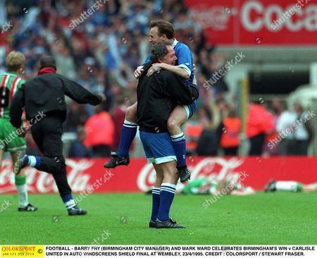 FOOTBALL - BARRY FRY (BIRMINGHAM CITY MANAGER) AND MARK WARD CELEBRATES BIRMINGHAM'S WIN v CARLISLE UNITED IN AUTO WINDSCREENS SHIELD FINAL AT WEMBLEY 23/4/1995 Great Britain London