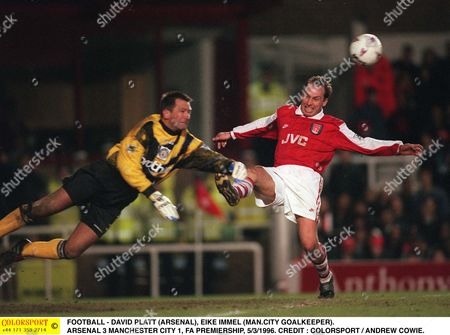 Stock Image of FOOTBALL - DAVID PLATT (ARSENAL) EIKE IMMEL (MAN CITY GOALKEEPER) ARSENAL 3 MANCHESTER CITY 1 FA PREMIERSHIP 5/3/1996 Great Britain London