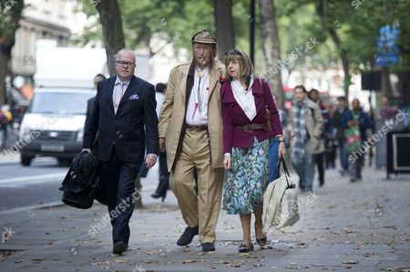 John McCririck arrives with his wife Jenny McCririck and his solicitor Stephen Beverley