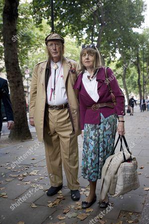 John McCririck arrives with his wife Jenny McCririck