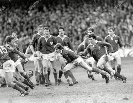 Oliver Campbell - Ireland/Old Belvedere Pursued by Billy James (Wales) Wales v Ireland at Cardiff Arms Park 5/3/83 Great Britain Cardiff 5 Nations Championship