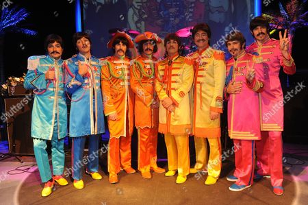 Seeing Double.the Beatles Re-borna. From The Left The Pauls Ian Garcia And Emanuele Angeletti The Georges John Brosnan And Stephen Hill The Johns Michael Galiano And Reuven Gershon And The Ringos. Gordon Elsmore And Phil Martin .at The Prince Of Wales Theatre London.
