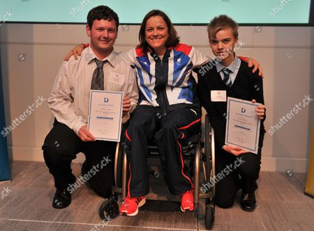 London  UK  24/09/2012 London 2012 Andrew Clarke 17 From Oxfordshire (left) And Scott Sobanja 16 From Shropshire (right) With Martine Wright (middle) Paralympic Sitting Vollyball Athlete Who Was A Victim Of The 7/7 London Bombings In 2006 And Is Presenting Some Of The Awards At Thethe National Diana Award Ceremony Barclays Building Canary Wharf London Andrew And Scott Are Receiving The Diana Award For Voluenteering.