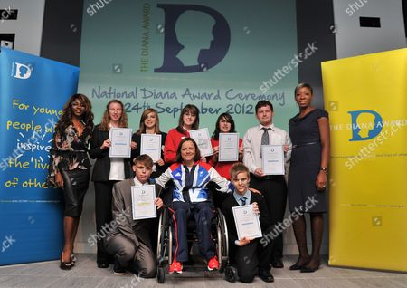 London  UK  24/09/2012 London 2012 Top Row L-r Sinitta Emma Mcknight (14) From Essex Katie Sorrell (14) From Essex Rebekah Hedges (14) From Gloucestershire Carrie Nicholls (14) From Gloucestershire And Andrew Clarke (17) From Oxfordshire And Tessy Ojo (patron Of The Diana Award) Bottom Row Left: Connor Rowntree (18) From Houghton Le Spring And Right: Scott Sobanja 16 From Shropshire With Martine Wright (bottom Middle) Paralympic Sitting Vollyball Athlete Who Was A Victim Of The 7/7 London Bombings In 2006 Is Presenting Some Of The Awards At Thethe National Diana Award Ceremony Barclays Building Canary Wharf London.