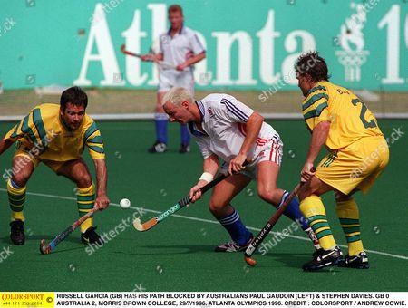 RUSSELL GARCIA (GB) HAS HIS PATH BLOCKED BY AUSTRALIANS PAUL GAUDOIN (LEFT) & STEPHEN DAVIES HOCKEY GB 0 AUSTRALIA 2 MORRIS BROWN COLLEGE 29/7/1996 ATLANTA OLYMPICS 1996 USA Atlanta