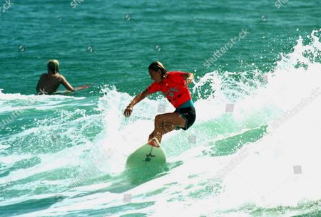 Stock Picture of Lisa Andersen surfs hard in the Billabong Pro Kirra Gold Coast Wednesday 12th March 1997 Photo : Robert Vijsma ©Action Photographics Australia Kirra