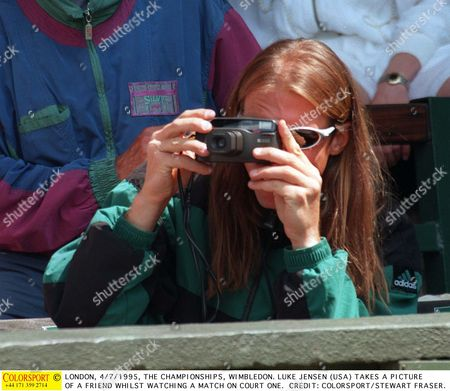 LONDON 5/7/1995 THE CHAMPIONSHIPS WIMBLEDON LUKE JENSEN (USA) TAKES A PICTURE OF A FRIEND WHILST WATCHING A MATCH ON COURT ONE Great Britain London