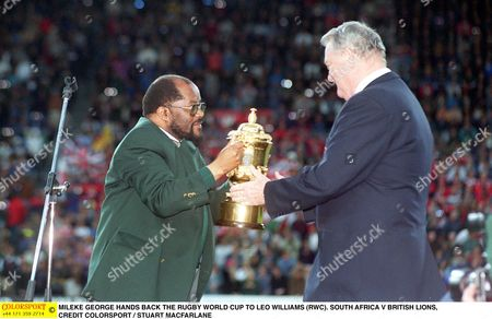MILEKE GEORGE HANDS BACK THE RUGBY WORLD CUP TO LEO WILLIAMS (RWC) SOUTH AFRICA V BRITISH LIONS South Africa