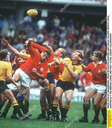 WADE DOOLEY (HEADBAND) DEAN RICHARDS (CENTRE) AND FINLAY CALDER (RIGHT) LIONS AUSTRALIA V THE BRITISH LIONS 3RD TEST 15/7/89 Australia