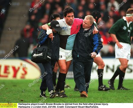 Harlequins player/coach Zinzan Brooke is carried from the field after a knee injury Harlequins v London Irish 23/1/99 Great Britain London